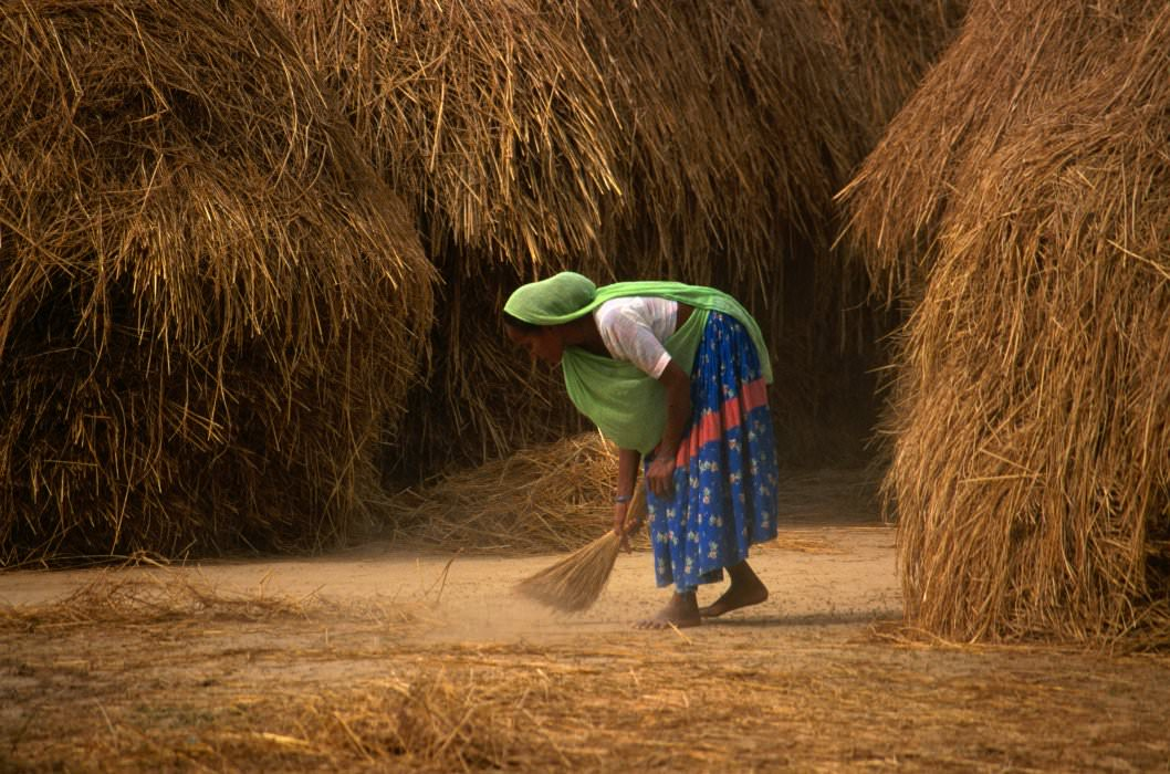 A Tharu woman sweeping